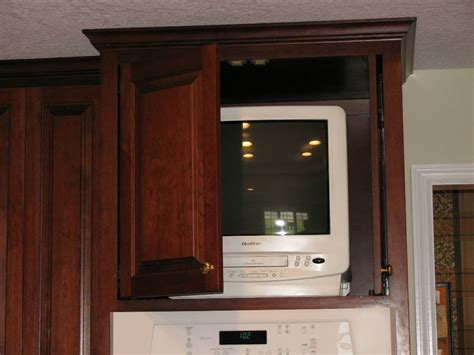 tv in kitchen cabinet kitchens foley custom cabinets