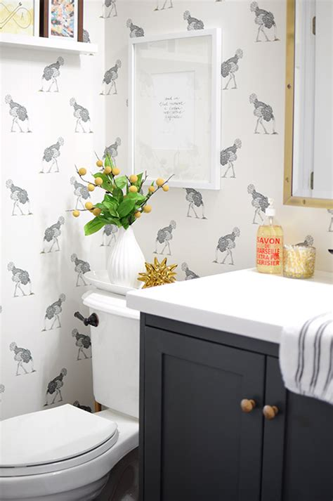 design sponge bathrooms before after a bathroom gets dressed up with wallpaper