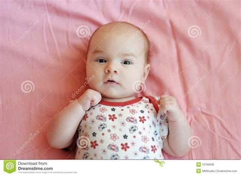 baby 4 months royalty free four month baby on a pink blanket royalty free stock photos image 12766638