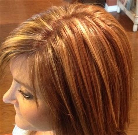 warm color hair highlight palette golden blonde highlights in a warm brown base with various