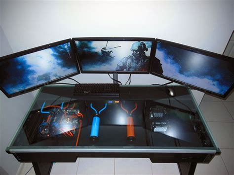 Built In Pc Desk by Amazing Liquid Cooled Computer Built Directly Into A Desk Complete With Three Displays Techeblog