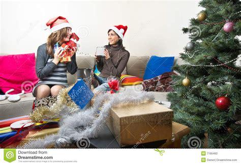friends preparing christmas presents stock photo image