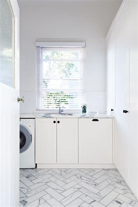 white laundry 1000 ideas about herringbone marble floor on