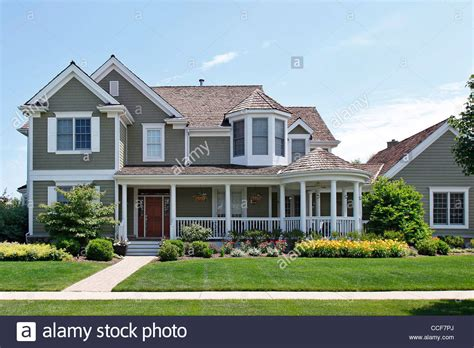 house with a porch stock photo image of chairs home 41010732 suburban home with green siding and front porch stock