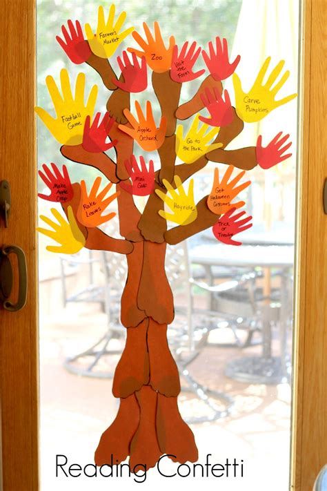 fall arts and crafts for family handprint and footprint fall tree reading confetti