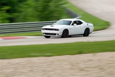 dodge m4 can you compare the dodge challenger hellcat and bmw m4