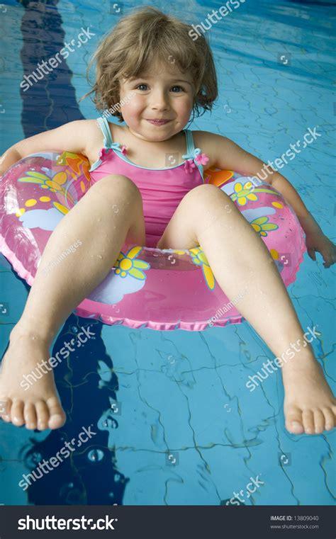 tube little girl little girl inner tube floating on stock photo 13809040