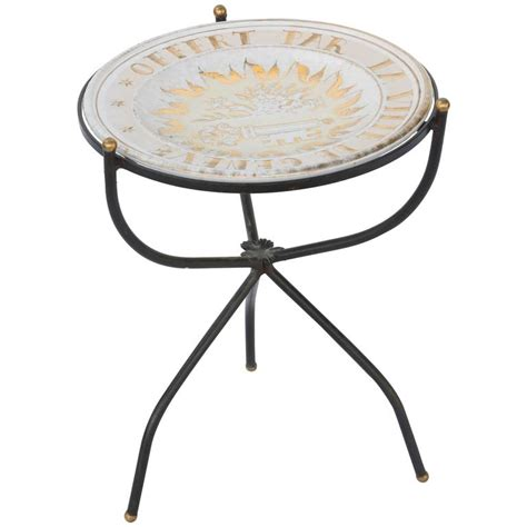 iron accent table iron accent table with glazed terracotta charger top for