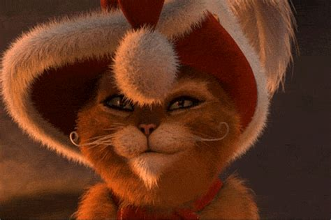 merry christmas  puss  boots gifs
