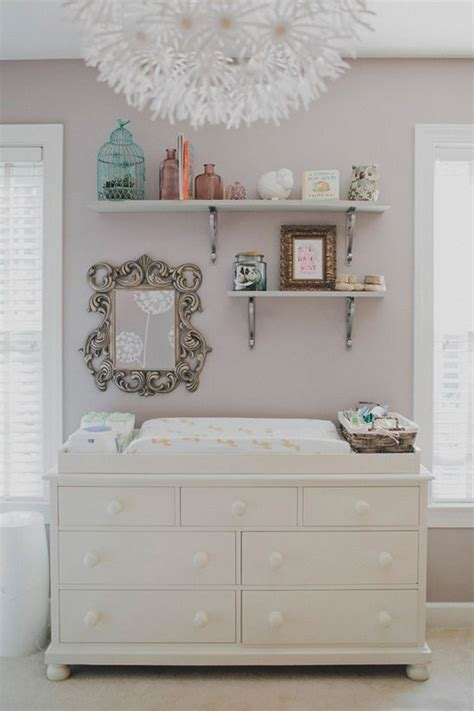 picture of white changing table with storage shelves above it