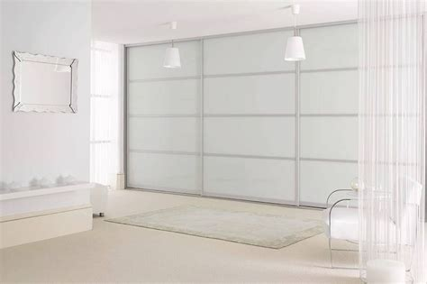 White Glass Sliding Wardrobes by Sliderobes Fitted Sliding Wardrobe Doors In White Glass Silver