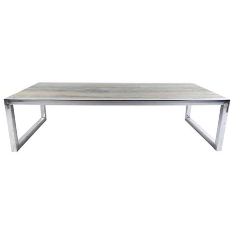 mid century modern marble and chrome coffee table in the