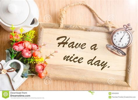 a day bilder a day text in blank wooden photo frame stock