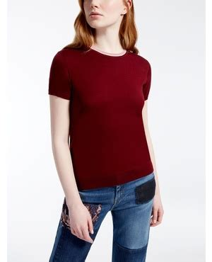 Our Sweater Dals sweater with shoulder splits and safety pin embellishent