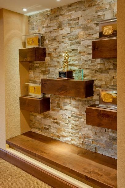 floating wood shelves  natural stone wall stone wall
