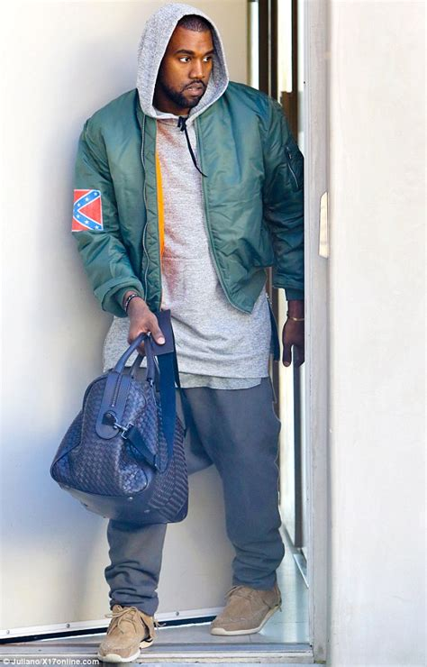 Kanye West defies critics and wears controversial Confederate Flag jacket to boxing class