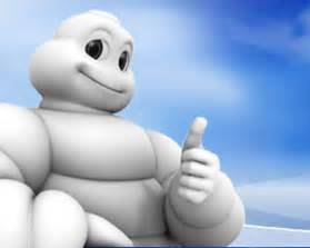 Michelin man gives a thumbs up to playing with glass kids