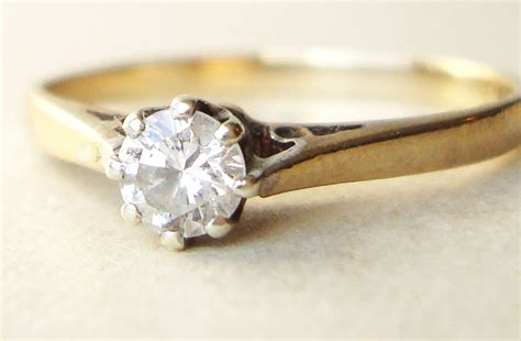 simple yellow gold engagement ring with