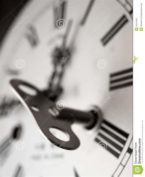 themes relating to time winding clock stock image image 31614031