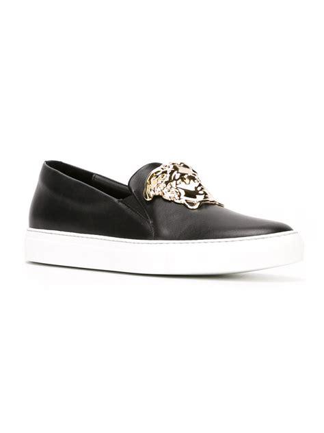 versace sneakers for lyst versace medusa slip on sneakers in black