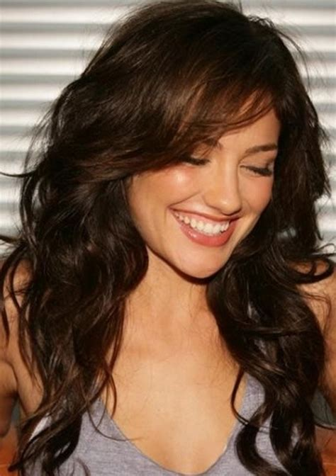 pictures of layered curly hairstyles with bangs layered haircuts with side swept bangs