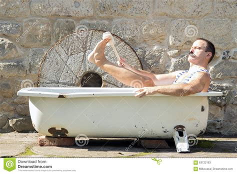 man in a bathtub man in the outdoor bathtub stock photo image 63722163
