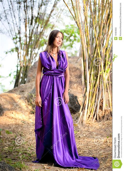 beautiful woman wearing  long purple dress royalty