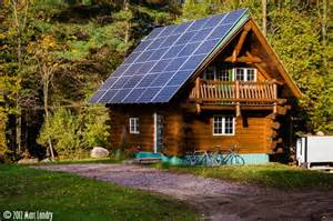 log cabin w solar panels woods