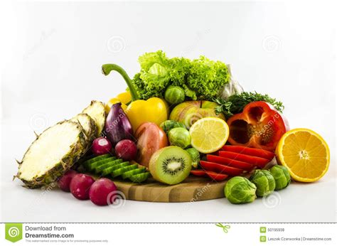 fresh cut fruits and vegetables composition of fruits and vegetables on wooden board cut