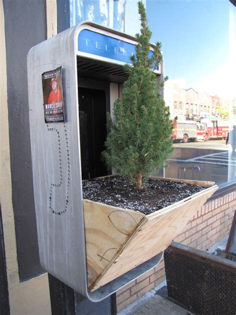 repurposed phone box  tree planters  gardens