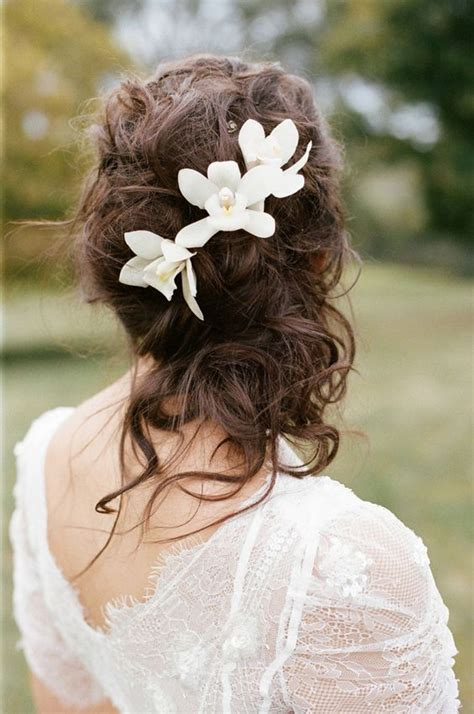 wedding hair updos flowers picture of curly wedding half updo with tropical flowers