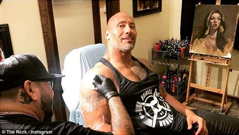 dwayne johnson tattoo left arm dwayne johnson shares story behind his updated arm tattoo