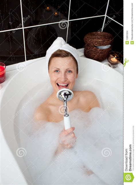 girl singing in bathroom happy woman singing in a bubble bath stock images image