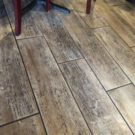 laminate flooring that looks like wood i love this floor it s tile that looks like wood i bet