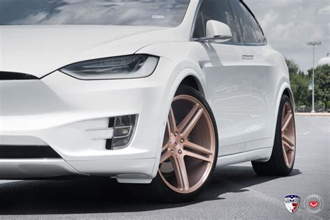 B 0012 Wheels Tesla Model X white tesla model x sits on gold vossen forged wheels tesla model x forged