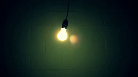 swinging light light bulb swinging in dirty dark room stock video footage