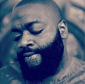 rick ross just got a rich forever tattoo on his chin