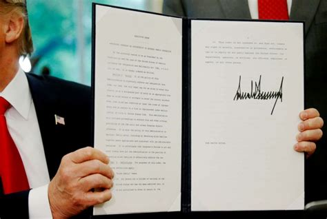 Executive Order signs executive order he says will keep immigrant