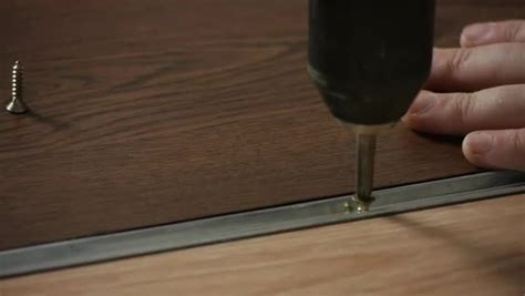 Video: How to Install T Moulding Transition on a Hardwood