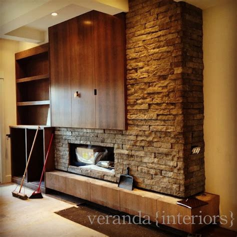 fireplace and accent wall with wood hearth you