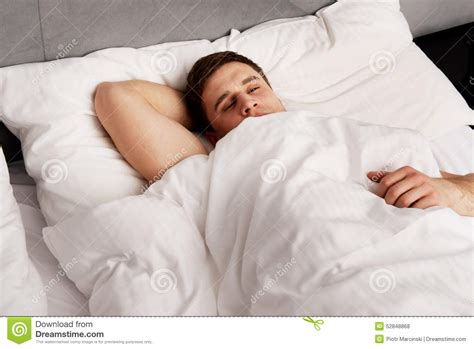 man in bed handsome young man lying in bed stock photo image 52848868