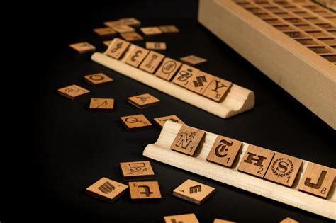 scrabble brand ete wooden scrabble imagined with brand logos fubiz media