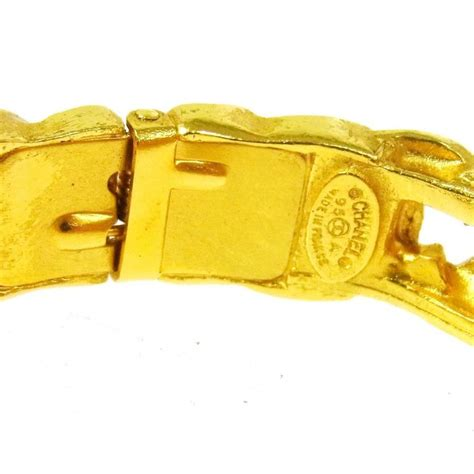 A25 Bangle For Luxury Evening chanel vintage gold charm logo cutout evening cuff bangle