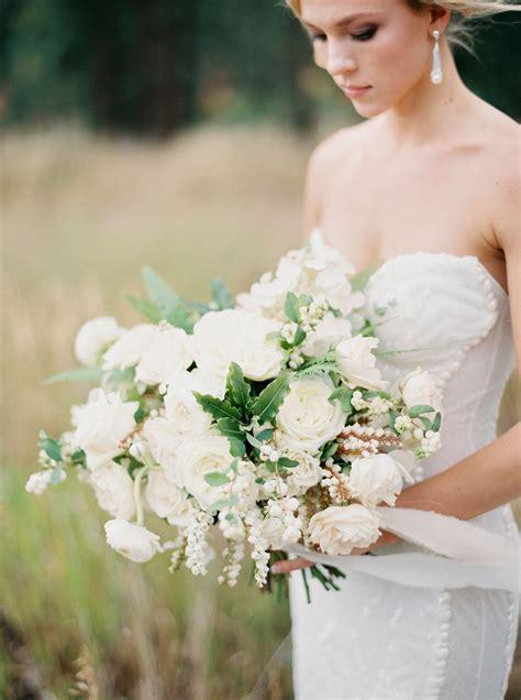 white  cream roses  greenery bridal bouquet