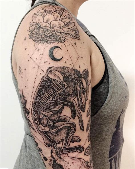 tattoos of flora and fauna reminiscent of woodcut etchings