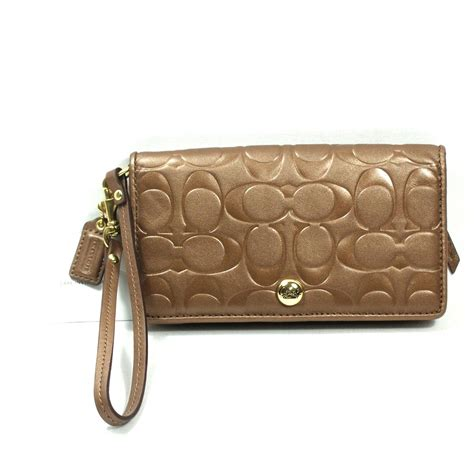 couch clutch coach embossed leather demi clutch wristlet wallet