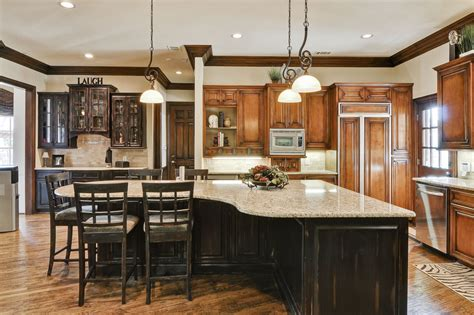kitchen island with cabinets and seating depiction of allow extra room for dining with a large