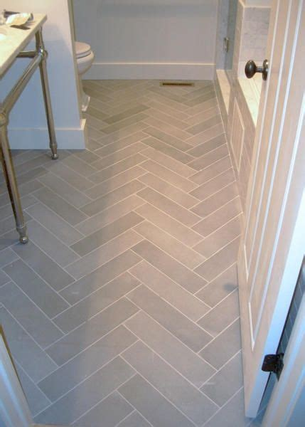 flooring in the bathroom and laundry room bathroom flooring light tile in herringbone pattern