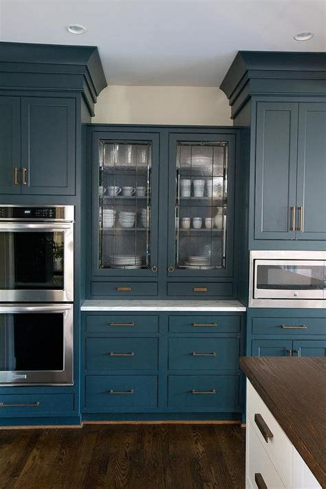 blue cabinets exquisite laundry room features a glass quatrefoil lantern