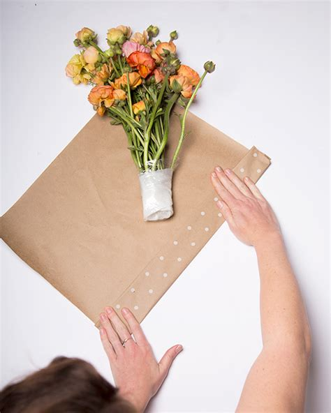 How To Make Wrapping Paper Flowers - how to wrap a bouquet of fresh flowers and a secret
